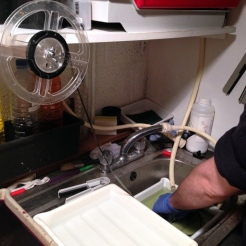 The film is washed carefully and all traces of the rem-jet are removed by hand. The wet film is wound onto a spool.