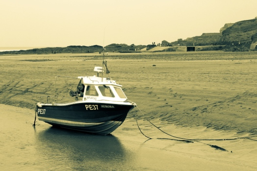 Boat at low tide at Bude
